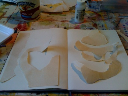 This is just my Moleskine sketchbook (that I love!) and some scrap paper.  I used some plain glue and a paint brush to glue them to the page.  I tore the paper very randomly, trying to get different kinds of shapes.
